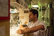 New York, NY, Sept. 10....shots of the restaurant Estela. Chef Ignacio Mattos expediting orders.