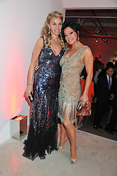 Left to right, ASSIA WEBSTER and NANCY DELL'OLIO at a dinner in aid The Journalism Foundation held at Philips De Pury & Company, Howick Place, London, SW1 on 22nd May 2012.