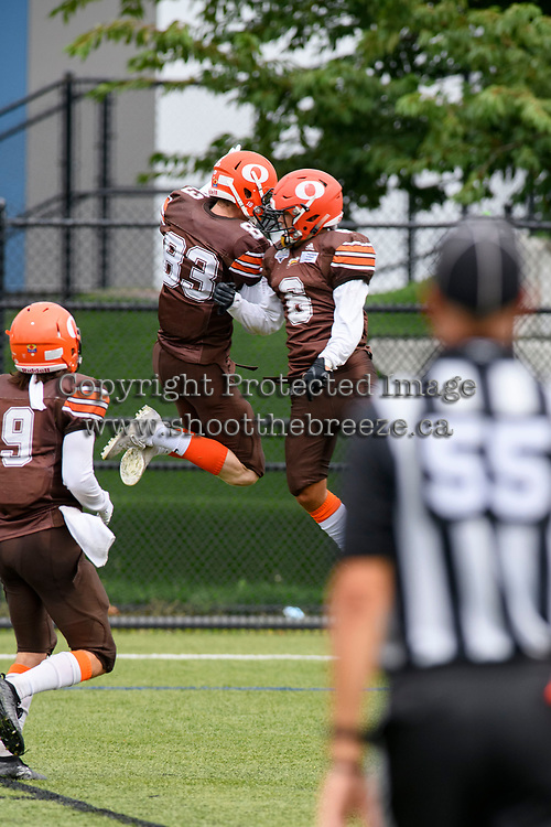 CHILLIWACK, BC - SEPTEMBER 11: Mike O'Shea #83 and Nathan Tonogai #6 of Okanagan Sun celebrate a touchdown against the Westshore Rebels at Exhibition Stadium in Chilliwack, BC, Canada. (Photo by Marissa Baecker/Shoot the Breeze)