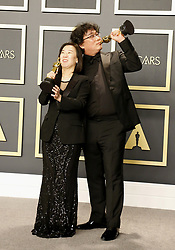 Bong Joon-ho and Kwak Sin-ae at the 92nd Academy Awards - Press Room held at the Dolby Theatre in Hollywood, USA on February 9, 2020.