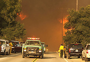 Fire engines pass by the wildfire on the Placenta Canyon Road in Santa Clarita, Calif., Sunday, July 24, 2016.(AP Photo/Ringo H.W. Chiu)