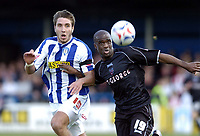 Photo: Olly Greenwood.<br />Colchester United v Brentford. Coca Cola League 1. 01/04/2006. Colchesters Garry Richards and Brentfords Callam Willcock