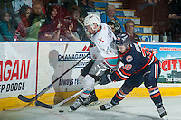 KELOWNA, CANADA - MARCH 26: Rourke Chartier #14 of Kelowna Rockets is checked by Dawson Davidson #38 of Kamloops Blazers on March 26, 2016 at Prospera Place in Kelowna, British Columbia, Canada.  (Photo by Marissa Baecker/Shoot the Breeze)  *** Local Caption *** Rourke Chartier; Dawson Davidson;