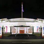 Panoramic shot of Australia's Old Parliament House at night.