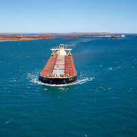 Loaded iron ore ship departing dampier