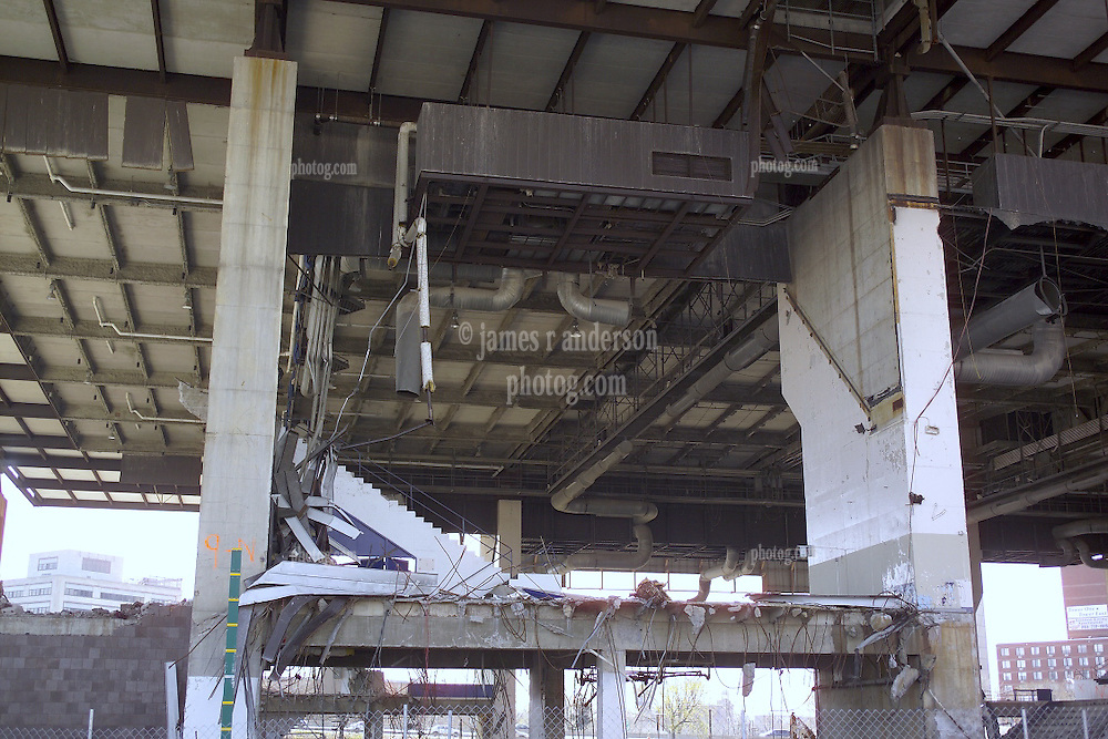 "Razing the New Haven Coliseum. Deconstruction Project as seen on 13 April 2006 from Crown Street. North West Elevation showing under garage steel detail, HVAC, support piers, venue ceiling and the parking garage above. The Garage was eventually ""Imploded"" to ground level for removal."
