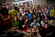 William DeShazer/Staff<br /> Students begin to pray as Bergoglio of Argentina is announced as the new Pope at Ave Maria University's Bob Thomas Student Union building on Wednesday March 13, 2013.