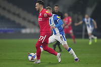 Huddersfield Town's Lewis O'Brien in action with  Birmingham City's Ivan Sanchez<br /> <br /> Photographer Mick Walker/CameraSport<br /> <br /> The EFL Sky Bet Championship - Huddersfield Town v Birmingham City - Tuesday 2nd March 2021 - The John Smith's Stadium - Huddersfield<br /> <br /> World Copyright © 2020 CameraSport. All rights reserved. 43 Linden Ave. Countesthorpe. Leicester. England. LE8 5PG - Tel: +44 (0) 116 277 4147 - admin@camerasport.com - www.camerasport.com
