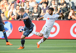 May 13, 2018 - Los Angeles, CA, U.S. - LOS ANGELES, CA - MAY 13: Los Angeles FC forward Diego Rossi (9) kicks the ball with New York City midfielder Alexander Ring (8) defending during the game between New York City FC and the Los Angeles FC on May 13, 2018, at Banc of California Stadium in Los Angeles, CA. (Photo by David Dennis/Icon Sportswire) (Credit Image: © David Dennis/Icon SMI via ZUMA Press)