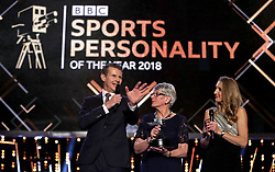 Dorothy Hyman (centre) is presented with BBC Sports Personality of the Year award from 1963 that she didn't receive at the time from Steve Cram and Paula Radcliffe (right) during the BBC Sports Personality of the Year 2018 at Birmingham Genting Arena.