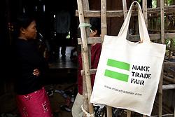 Oxfam fair trade bag at the Takom village rice bank in Cambodia.
