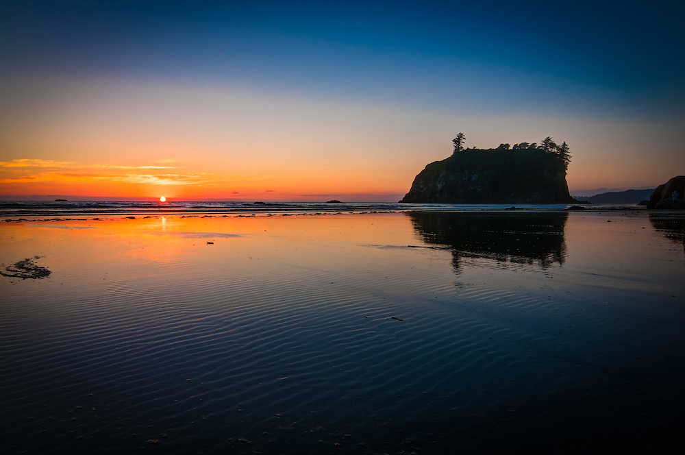 A perfect combination of low tide, the last rays of sunlight, and a spectacular  location made for a very satisfying photograph with rippled sand and ultra-vivid colors as I waited out the sunset on Washington's Ruby Beach in the Olympic National Park on the Pacific Ocean.