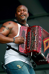 27 April 2013. New Orleans, Louisiana,  USA. .New Orleans Jazz and Heritage Festival. Dwayne Dopsie and the Zydeco Hellraisers on the Fais Do-Do stage..Photo; Charlie Varley.
