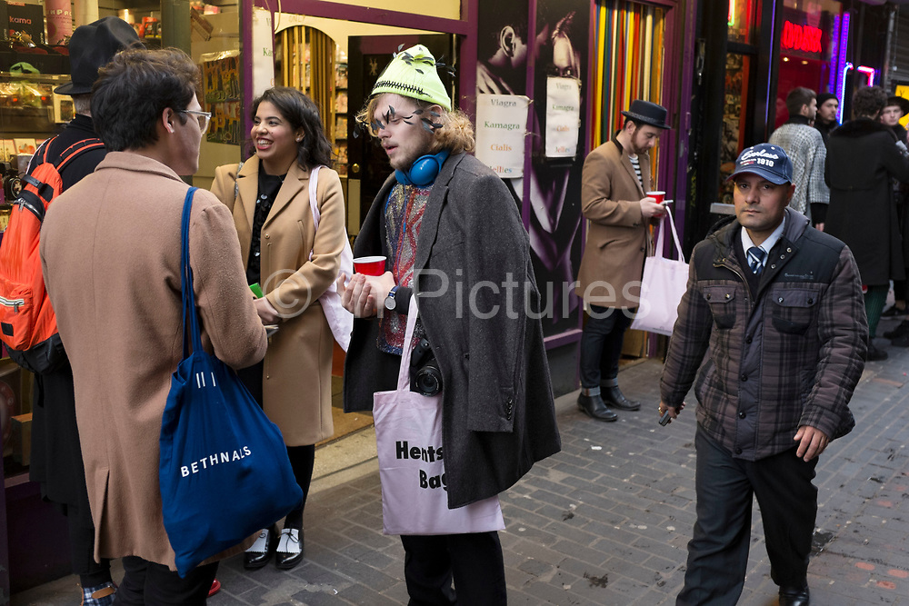 Fashionistas gather in Walker Court (aka Sex Lane) in Soho London for the launch of the Hentsch Man Peep Show, Autumn Winter fashion collection. Hentsch Man was launched in 2008 by childhood friends, Alexia Hentsch and Max von Hurter and is known as a brand original values of simplicity, good tailoring, quality and pricing.