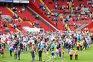 Pitch invaders, both Charlton and Burnley fans during the Sky Bet Championship match between Charlton Athletic and Burnley at The Valley, London, England on 7 May 2016. Photo by Matthew Redman.
