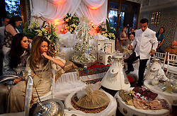 Relatives and guests look at the wedding gifts brought to the event by groom Nabil Abou et Ainine, 33, who arrived with family just moments earlier in Casablanca, Morocco on May 10, 2009. He and his bride, Meryem Benanine, 32,  were married in a traditional ceremony arranged by their families.