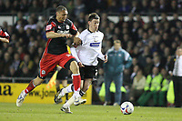 Photo: Pete Lorence.<br />Derby County v Queens Park Rangers. Coca Cola Championship. 13/03/2007.<br />Michael Mancienne and David Jones charges into the penalty area.