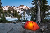 Tent illuminated at dusk in backcountry camp at Mirror Lake, Eagle Cap Wilderness Oregon