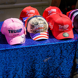 Harrisburg, PA / USA - May 15, 2020: A vendor parked along a street in the downtown part of the city displays Trump 2020 campaign hats for sale during a quarantine protest.