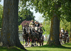 © London News Pictures. 15/05/2016. Windsor, UK. A horse drawn carriage pass through the grounds of Windsor Castle on the final day of the 2016 Royal Windsor Horse Show, held in the grounds of Windsor Castle in Berkshire, England. This years event is part of HRH Queen Elizabeth II's 90th birthday celebrations.  Photo credit: Ben Cawthra/LNP