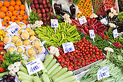 Fresh fruit vegetables tomato pimento oranges courgettes, beans Turkish lira prices at food market Kadikoy Asian Istanbul Turkey