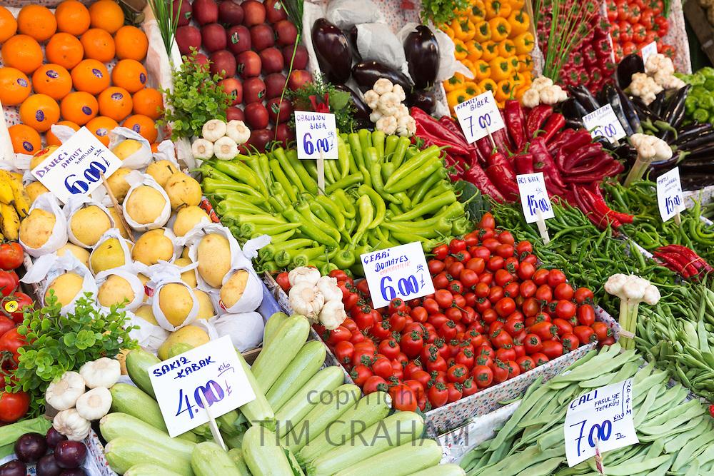 Fresh fruit vegetables tomato pimento oranges courgettes, beans Turkish lira prices at food market Kadikoy Asian Istanbul Turkey