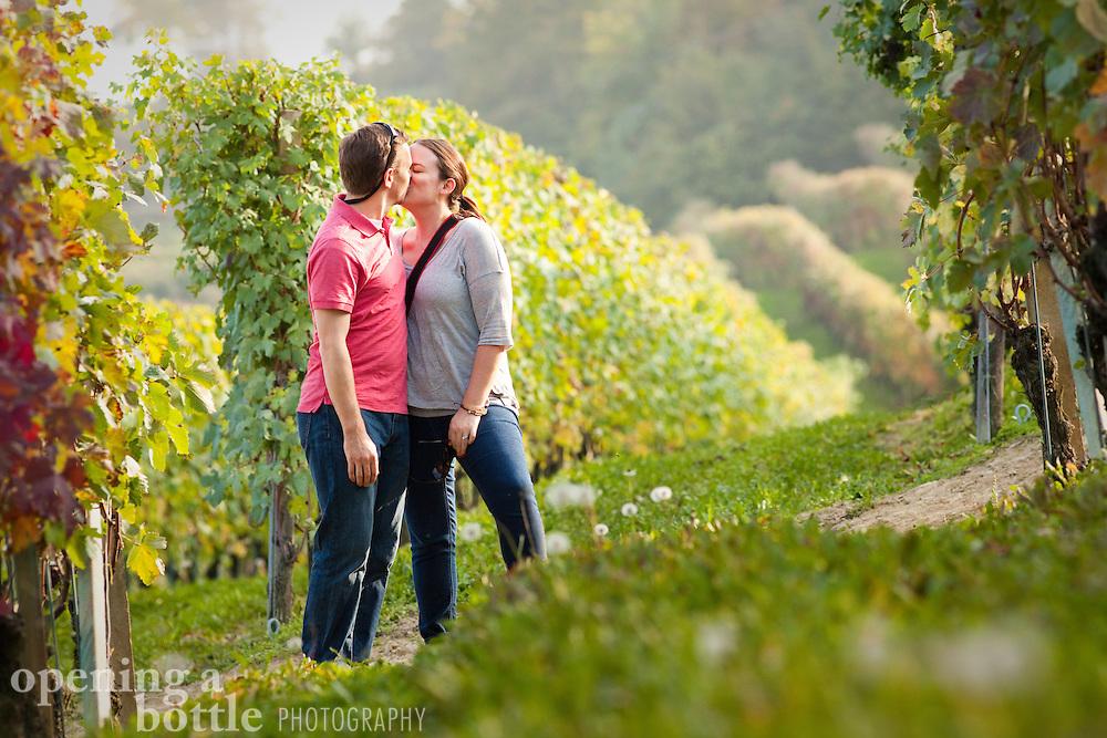 A romantic couple kisses in an Italian vineyard, in the famous wine region of Barolo, near La Morra (Piedmont), Italy. Model release available.