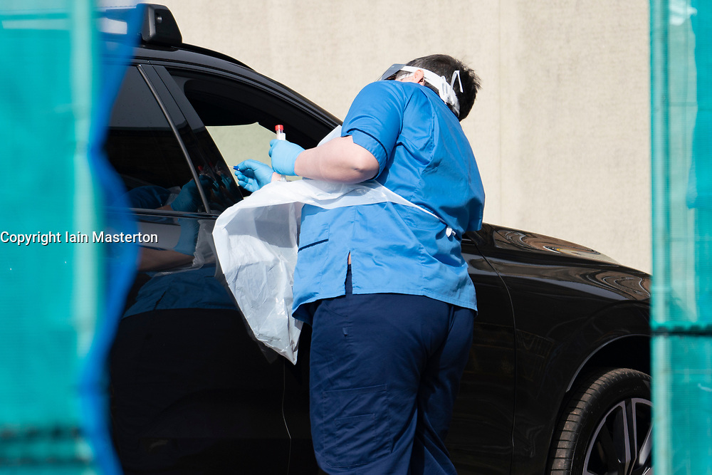 Edinburgh, Scotland, UK. 12 March, 2020. A nurse tests drivers for Coronavirus at special cordoned off drive-in testing facility at NHS Lothian Western General Hospital in Edinburgh today. Iain Masterton/Alamy Live News