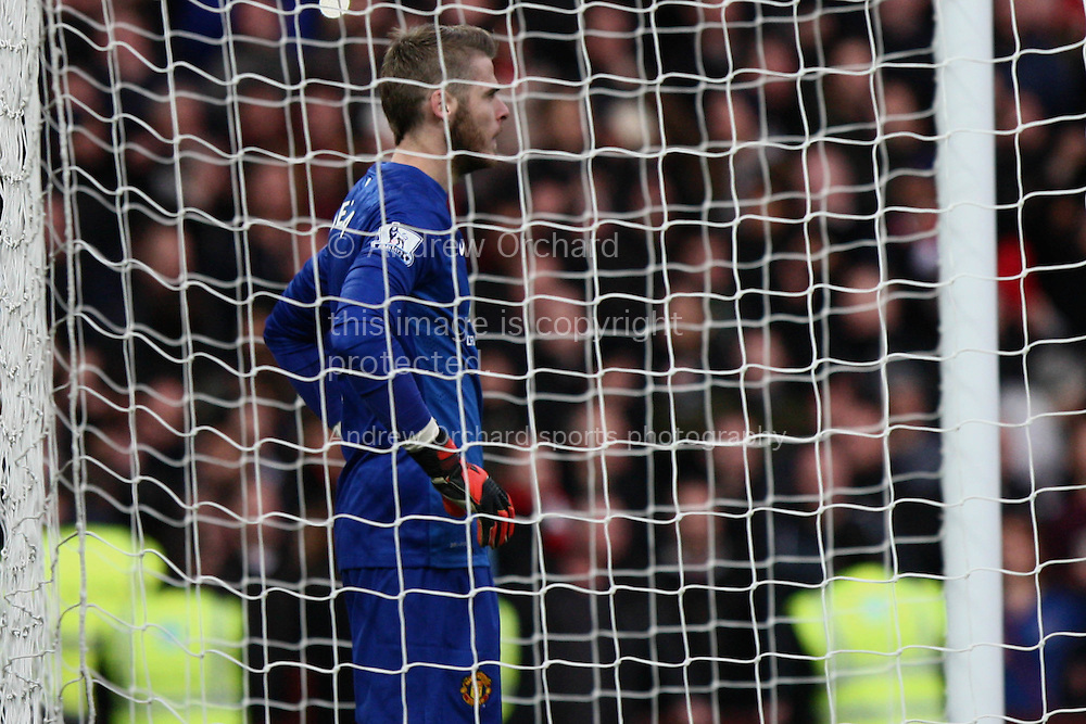 David De Gea of Manchester United reflects after conceding Villa's first goal. Barclays Premier league match, Aston Villa v Manchester Utd at Villa Park in Birmingham on Saturday 20th December 2014<br /> pic by Mark Hawkins, Andrew Orchard sports photography.