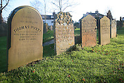 Gravestones in churchyard showing different degrees of weathering, Yoxford, Suffolk, England