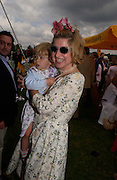 Baroness Issy van Randwyck  with her daughter Georgia Hall,  Veuve Clicquot gold Cup, Polo at Cowdray, 18 July 2004. SUPPLIED FOR ONE-TIME USE ONLY> DO NOT ARCHIVE. © Copyright Photograph by Dafydd Jones 66 Stockwell Park Rd. London SW9 0DA Tel 020 7733 0108 www.dafjones.com