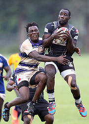 Rubun Oroko of Mean Machine tackles Brad Owako of Mwamba RFU during their Kenya Cup Tournament at Railway Club In Nairobi, on 3rd December 2016. Mwamba won 51-8. Photo/Fredrick Onyango/www.pic-centre.com (KEN)