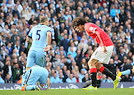 Spit comes out of the mouth of Manchester United's Marouane Fellaini as he shouts at Manchester City's Sergio Aguero<br /> <br /> - Barclays Premier League - Manchester City vs Manchester Utd - Etihad Stadium - Manchester - England - 2nd November 2014  - Picture David Klein/Sportimage