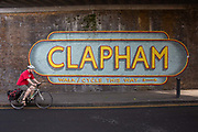 A man cycles past a Clapham wall mural under a Network Rail bridge on Ferndale Road on the 23rd May 2019 in London in the United Kingdom.