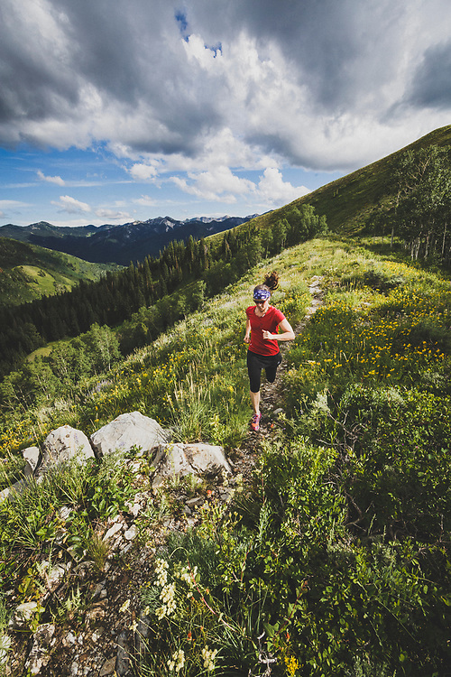 Jacki Arevalo trail running on Reynolds Peak, Wasatch Mountains, Utah.