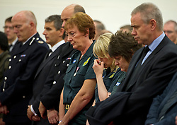 © London News Pictures. 24/10/2012. Harlow, UK. An emotional member of the ambulance service with other members of the emergency services at  the funeral service of Dr Sabah Usmani and her five children Hira (12), Sohaib (11) Muneeb (9), Rayyan (6) and Maheen (3) at Harlow Islamic Centre in Harlow, Essex, UK on October 24, 2012. Dr Sabah Usmani and her five children died blaze at their home in Harlow last week. Photo credit: Ben Cawthra/LNP