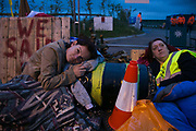 12 local activists locked themselves in specially made arm tubes to block the entrance to Quadrillas drill site in New Preston Road, July 03 2017, Lancashire, United Kingdom. Louise Robinson and Alana McCullough. The 13 activists included 3 councillors; Julie Brickles, Miranda Cox and Gina Dowding and Nick Danby, Martin Porter, Jeanette Porter,  Michelle Martin, Louise Robinson,<br /> Alana McCullough , Nick Sheldrick, Cath Robinson, Barbara Cookson, Dan Huxley-Blyth. The blockade is a repsonse to the emmidiate drilling for shale gas, fracking, by the fracking company Quadrilla. Lancashire voted against permitting fracking but was over ruled by the conservative central Government. All the activists have been active in the struggle against fracking for years but this is their first direct action of peacefull protesting. Fracking is a highly contested way of extracting gas, it is risky to extract and damaging to the environment and is banned in parts of Europe . Lancashire has in the past experienced earth quakes blamed on fracking.