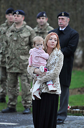 © Licensed to London News Pictures. 17 Jan 2013. Brize Norton, Oxfordshire. His baby Lilly Faith Walker (20mths) and his girlfriend Abbie Revill (23yrs). Repatriation of Sapper Richard Reginald Walker from 28 Engineer Regiment who was shot in an apparent 'insider attack' by a member of the Afghan National Army (ANA) at Patrol Base Hazrat in the Nahr-e Saraj district of Helmand province on Monday 7 January 2013 . Photo credit : MarkHemsworth/LNP