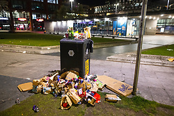 © Licensed to London News Pictures. 13/04/2021. Manchester, UK. Rubbish is piled up by a bin in Piccadilly Gardens at the end of a night out in Manchester City Centre , as government restrictions to control the spread of Coronavirus are eased across the UK. Pubs, restaurants, hairdressers, gyms and non essential retailers are now permitted to serve customers within restrictions. Photo credit: Joel Goodman/LNP