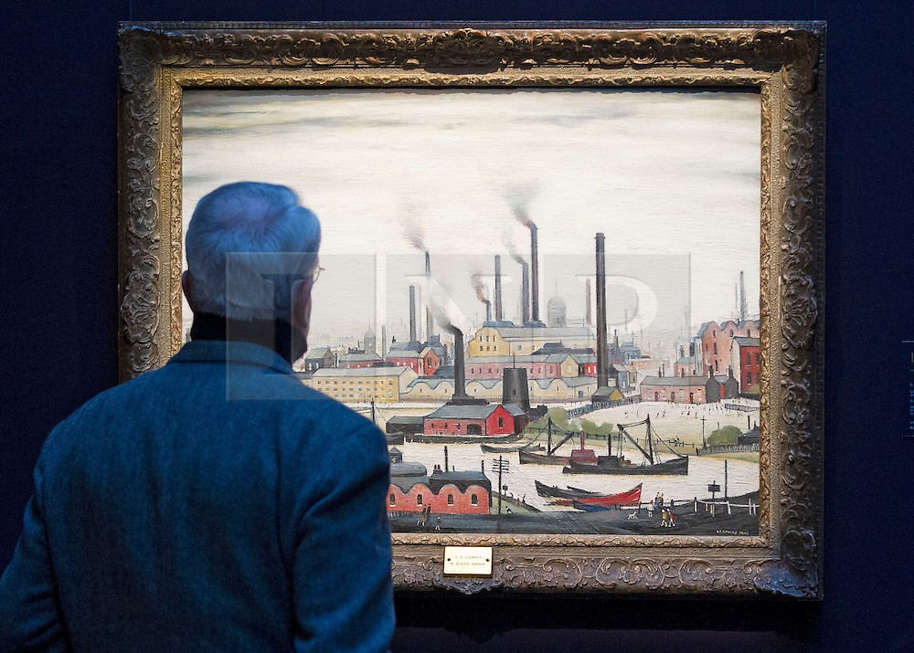"""© Licensed to London News Pictures. 21/03/2014. London, UK. A visitor to Sotheby's auction house views """"A River Bank"""" (1947) (est. GB£1.500,000-2,500,000) by British artist LS Lowry during the press view for a new sale of the artist's work in London today (21/03/2014). The auction, entitled """"Lowry: The AJ Thompson Collection"""", features works by Lowry assembled over a 30 year period by collector A.J. Thompson. Photo credit: Matt Cetti-Roberts/LNP"""