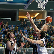 Fenerbahce Ulker's Darjus LAVRINOVIC (R) and Besiktas's Andrew James OGILVY (L) during their Turkish Basketball league derby match  Fenerbahce Ulker between Besiktas at Sinan Erdem Arena in Istanbul, Turkey, Saturday, March 12, 2011. Photo by TURKPIX