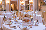 A decorated table set for afternoon tea at Palm Court at The Ritz on the 4th October 2019 in London in the United Kingdom. Palm Court is a glass-ceilinged venue for extravagant afternoon tea at the 5 star The Ritz hotel.