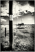 Telegraph pole and abandoned radar station at Dungeness