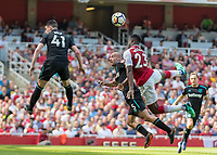 Football - 2017 / 2018 Premier League - Arsenal vs. West Ham United<br /> <br /> Danny Welbeck (Arsenal FC) strains to reach the header at The Emirates.<br /> <br /> COLORSPORT/DANIEL BEARHAM