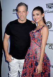 Designer Kenneth Cole and actress Victoria Justice attending the amfAR generationCURE Solstice at Mr. Purple on June 20, 2017 in New York City, NY, USA. Photo by Dennis Van Tine/ABACAPRESS.COM