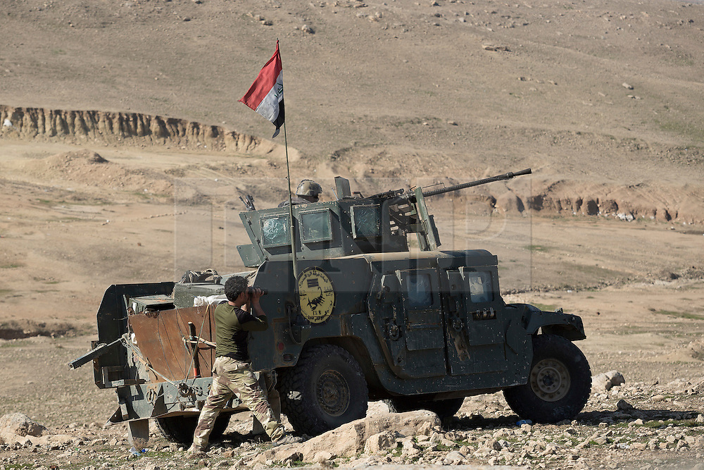 Licensed to London News Pictures. 20/02/2017. Albu Saif, Iraq. Iraqi Emergency Response Division soldiers watch from their armoured Humvees for any movement in the village of Albu Saif, Iraq.<br /> <br /> The settlement of Albu Saif is located on high ground overlooking Mosul Airport and as such is a strategic point that needs to be taken as part of the operation to retake the western side of Mosul. Photo credit: Matt Cetti-Roberts/LNP