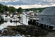 Lobster boats moored in the fishing community of New Harbor, Maine. The tiny picturesque pocket harbor is one of the last working harbors on the midcoast along the Pemaquid Peninsula