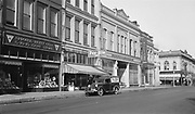 9305-A4373-4. The Dalles main street, Pay Rite store, 300 block of East Second. August 1935. The Dalles, Oregon.