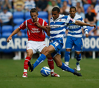 Photo: Steve Bond/Richard Lane Photography. Reading v Nottingham Forest. Coca Cola Championship. 08/08/2009. Hal Robson-Kanu (R) tackles Chris Cohen (L)