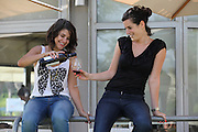 Two friend enjoy a glass of wine outdoors. Model release available
